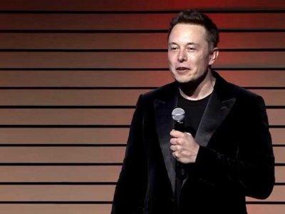 Tesla révèle son système de changement de batterie robotisé-2