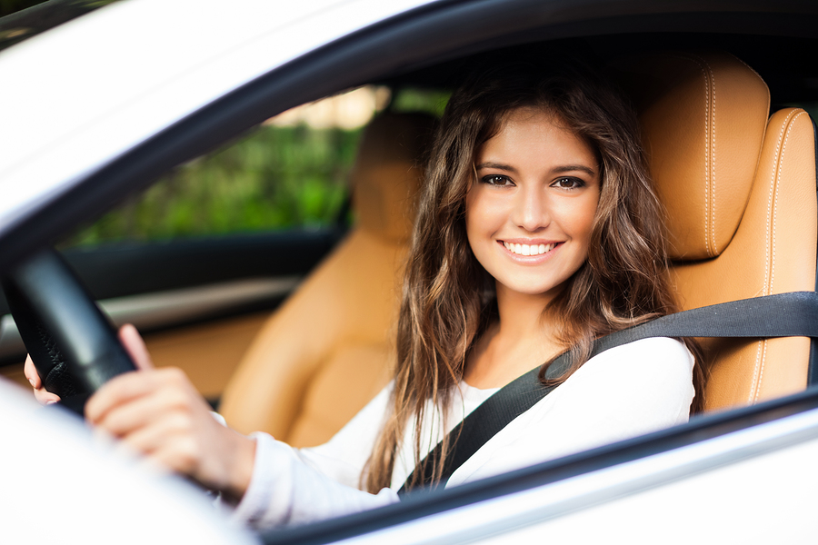 Young woman driving her car